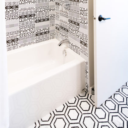 Hex Mosaic Floor and Patterned Subway Tile Wall